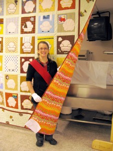 jacqui-showing-alines-quilt