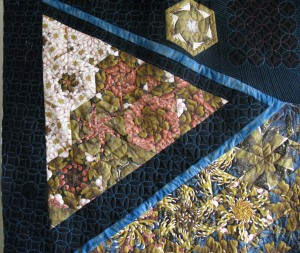 Jennie quilt floating triangle