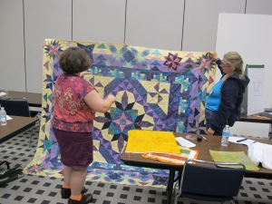 Teri_Lucas_class_6,_consulting_with_Frances_on_her_quilt!