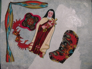 This was part of the process.  See St. Therese?  It's the fabric she's part of that I had a hard time cutting up.  Why do I have this fabric if I don't use it and can't enjoy it?