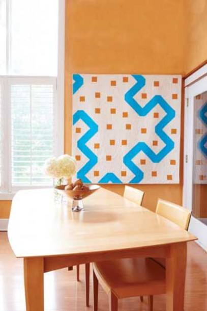 modern patchwork orange quilt on wall get name
